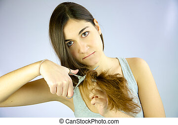 Cute girl ready to cut her long hair