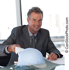 Mature Business man looking at Blueprints - Senior Engineer...