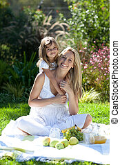 Mother and daugther Outdoors having fun - Young Mother and...