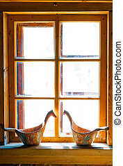 sunlit window Russian huts and carved buckets
