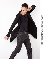 Male fashion model posing with hands up