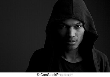 Mysterious man - Close up black and white portrait of a...