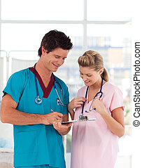 Portrait of doctor with attractive nurse in hospital -...
