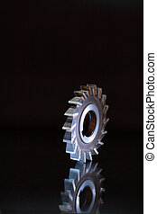 Saw Blade - Turning machine saw blade isolated on dark...
