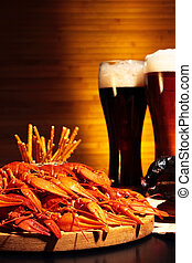 Dark and light beer with crawfish - Glasses of dark and...