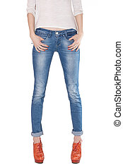 Shapely female legs dressed in blue jeans and orange boots...