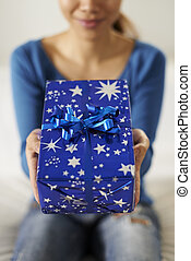 asian girl holding gift box to the camera