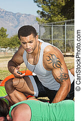 Trainer With Outdoor Fitness Class