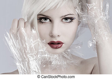 Blonde woman model in plastic - Beautiful girl model with...