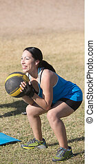 Smiling Woman Working Out - Smiling woman exercising with...