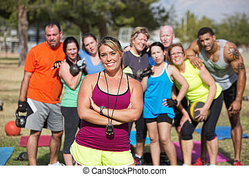 Confident Trainer with Fitness Class