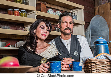 Sheriff and Woman Pose Inside House - Portrait of a sheriff...