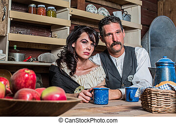 Western Sheriff and Woman Pose Inside House - Stern looking...