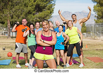 Happy Boot Camp Fitness Group - Group of happy people in...