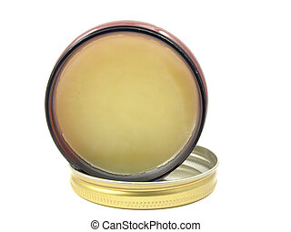Yellow hair wax in a little open glass with lid