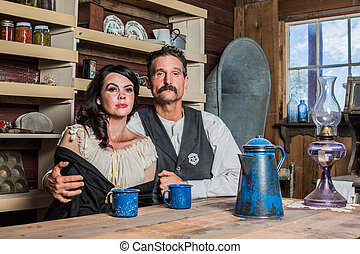 Deadpan Western Sheriff and Woman Pose Inside House -...