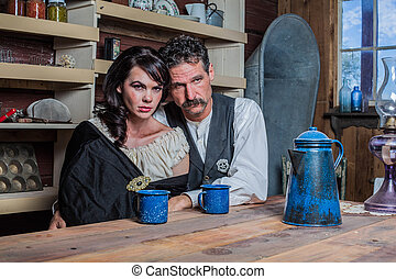 Serious Western Sheriff and Woman Pose Inside House -...