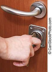 closing house door by key close up