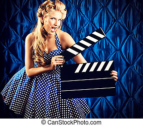 cinematography - Pretty pin-up woman with retro hairstyle...