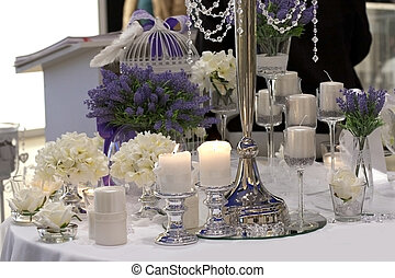 Table decorated with candles, lavender and white roses