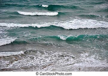 Ocean Water and Waves - A close-up of white-capped turquoise...
