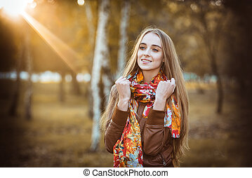 Woman in the park at the sunset time