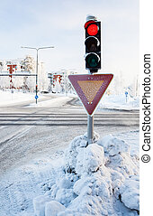 Red traffic light at winter