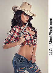 Beautiful brunette cowgirl. - Sexy brunette woman with...