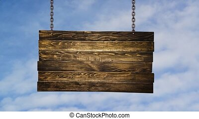 Wooden signpost hanging on chains o
