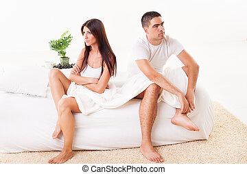 Relationship conflict - Angry Young couple sitting on the...