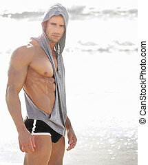 Sexy fit man - Portrait of a handsome muscular man at beach