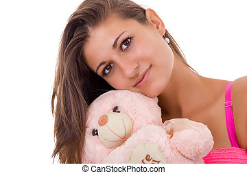pretty woman holding teddy bear reminding her of childhood -...
