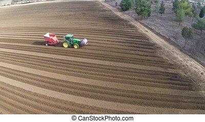 Flight Over Potato Field - Beautiful Aerial view of Tractor...