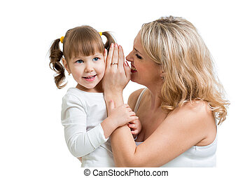 mother and daughter sharing a secret whispering