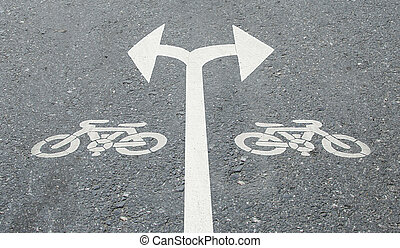 White arrow turn left and turn right with bicycle sign on...