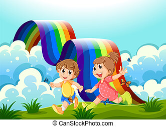 Happy kids playing at the hilltop with a rainbow -...