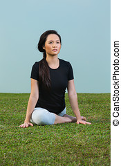 Chinese Woman in black t-shirt Performing yoga - Young...