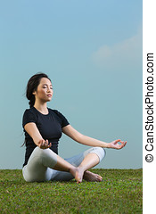 Chinese Woman in black t-shirt Performing yoga. - Young...