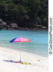 Beach umbrella on a sunny day, sea in background