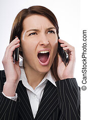 Upset - Young upset business woman talking on the mobile...