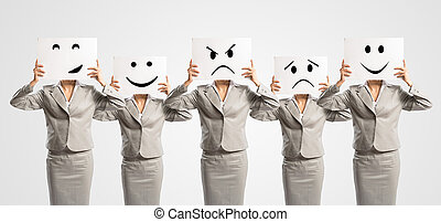 image of a businesswomen standing in a row, held in front of...