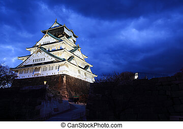 Osaka Castle in Osaka, Japan illuminated by spotlights...
