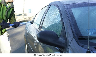 Scraping frosted car windows.