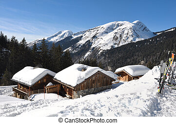 Savoie village in winter - cottages of Savoie village in the...