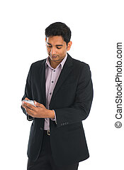 indian male business man using smartphone with white...