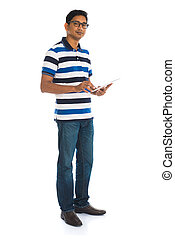 casual indian man with a generic tablet