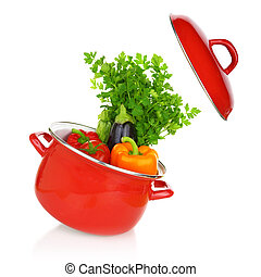 Colorful vegetables in a red cooking pot isolated on white...