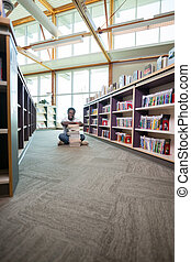 Student With Stack Of Books In Library - Full length...