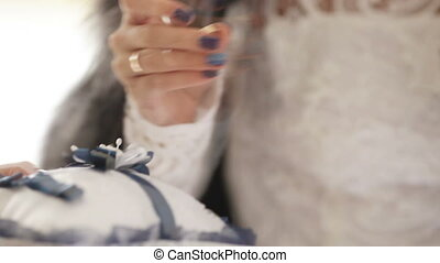 Donning wedding ring - Bride wears a wedding ring to the...