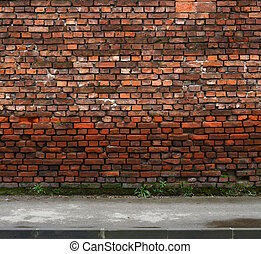 brick wall with sidewalk - old wethered brick wall with...